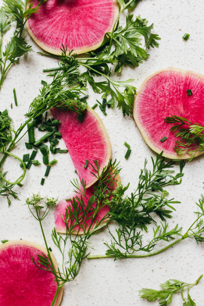 Close up of pink watermelon radishes