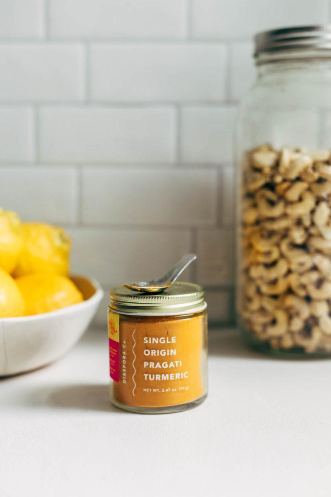 Close up of Diaspora turmeric jar on a kitchen counter