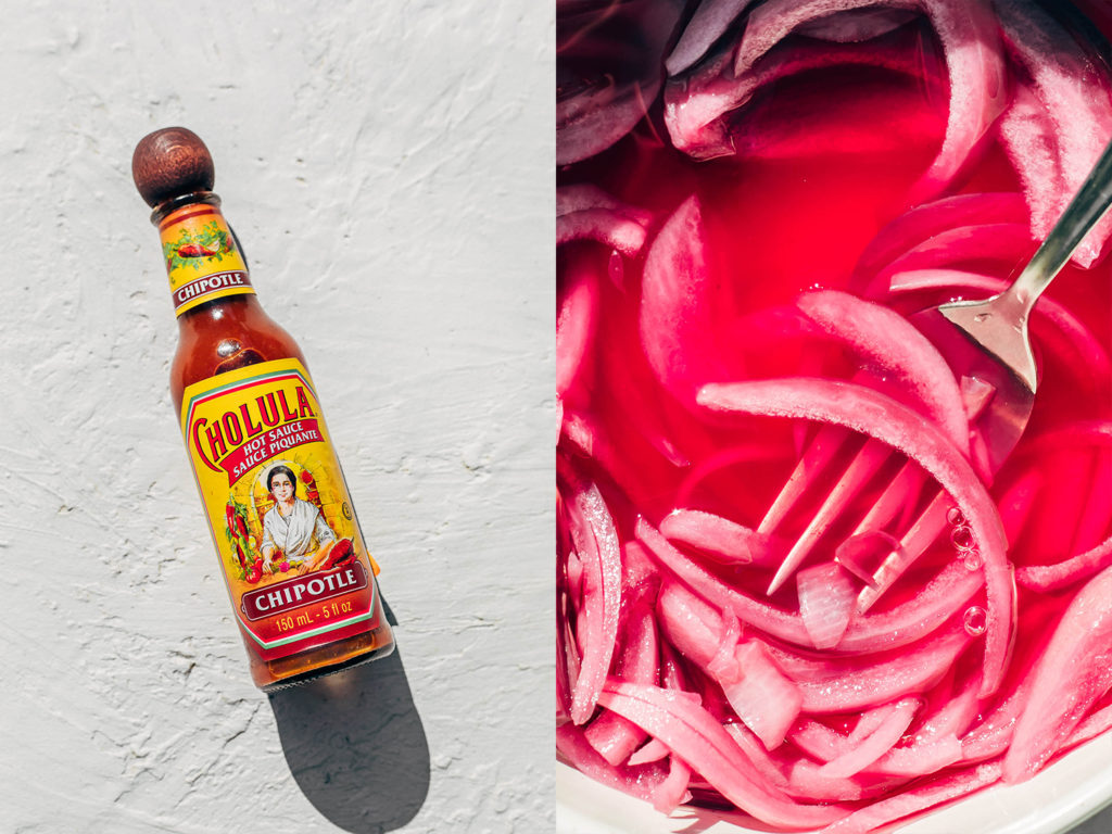 Bottle of hot sauce and close up of pink pickle onions.