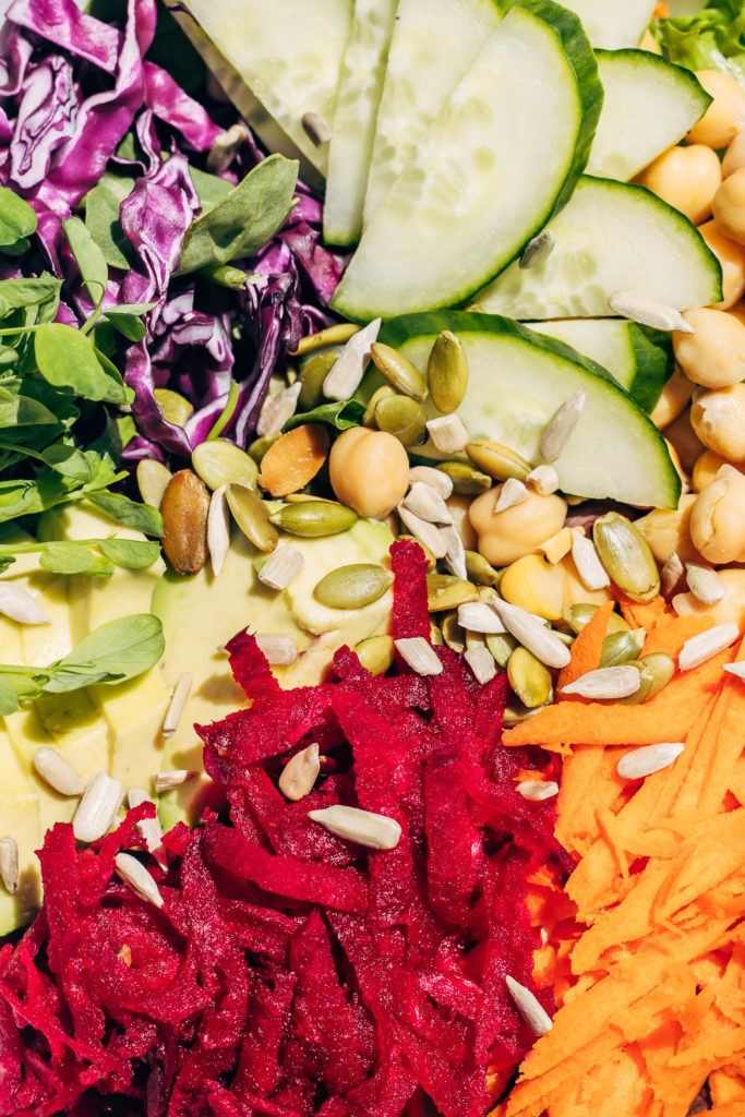 Close up of the different veggies used in rainbow salad making
