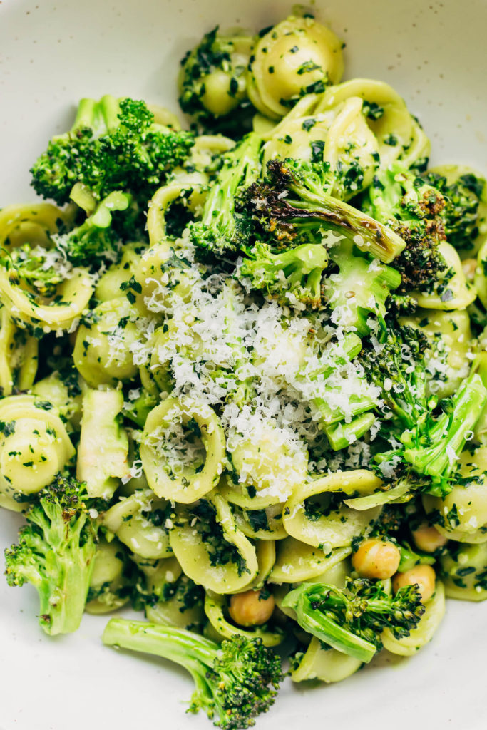 Close up of vegan kale pesto pasta in a bowl.