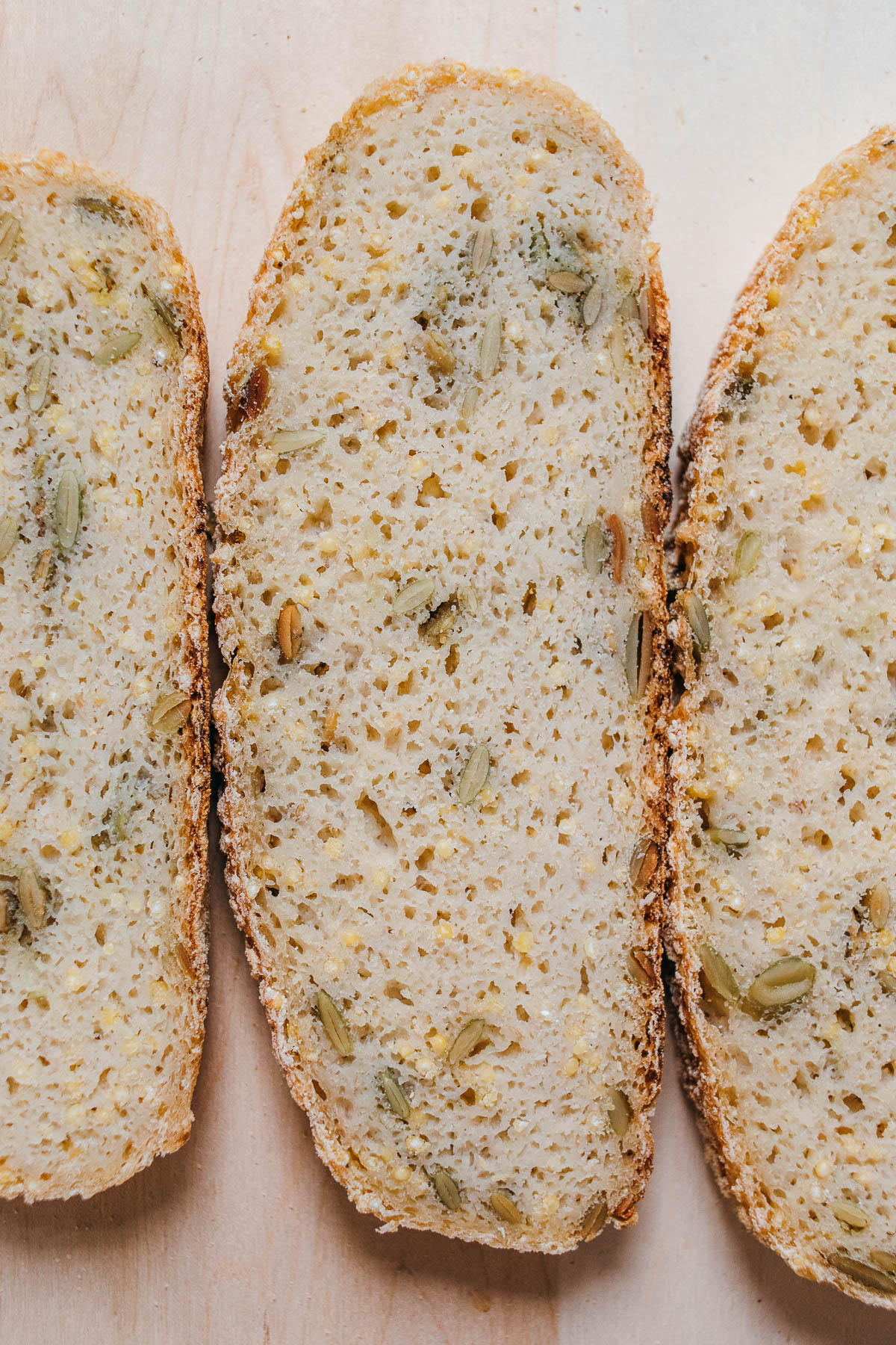 Overhead image of slices of gluten free sourdough bread to show airy texture.