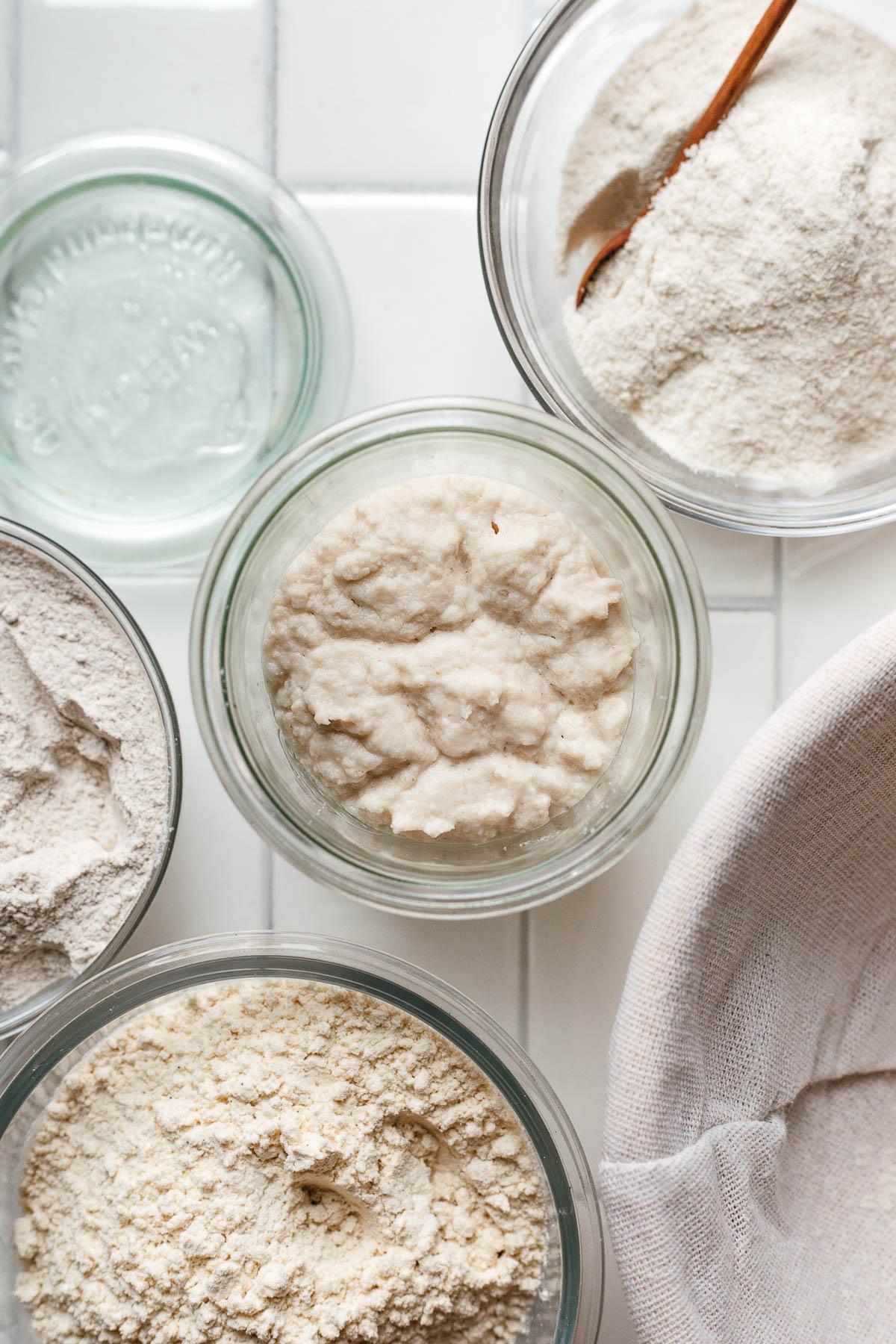 overhead of gluten free sourdough starter and gluten free flours
