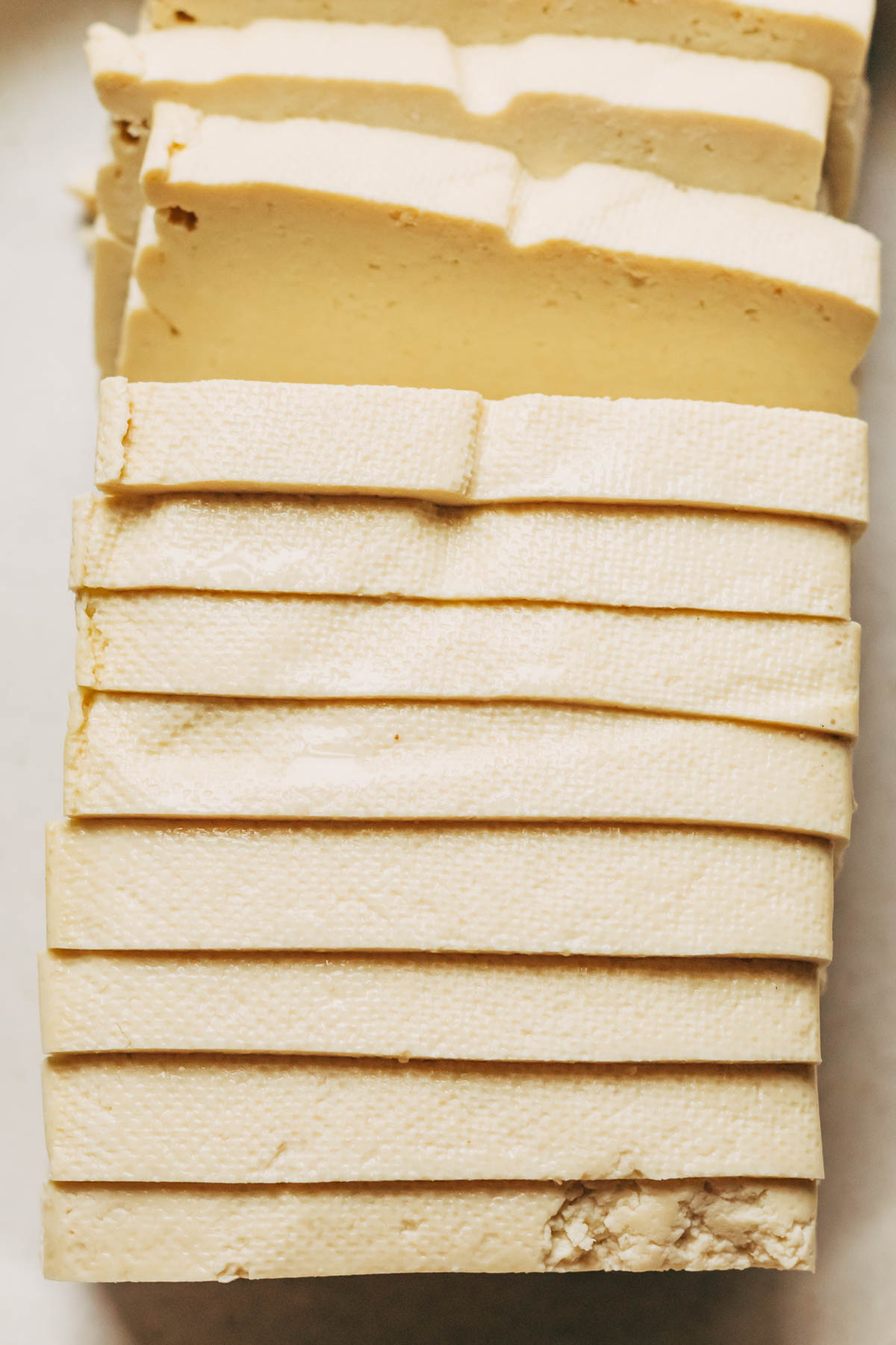 Close up of tofu slices to show the thickness desired.