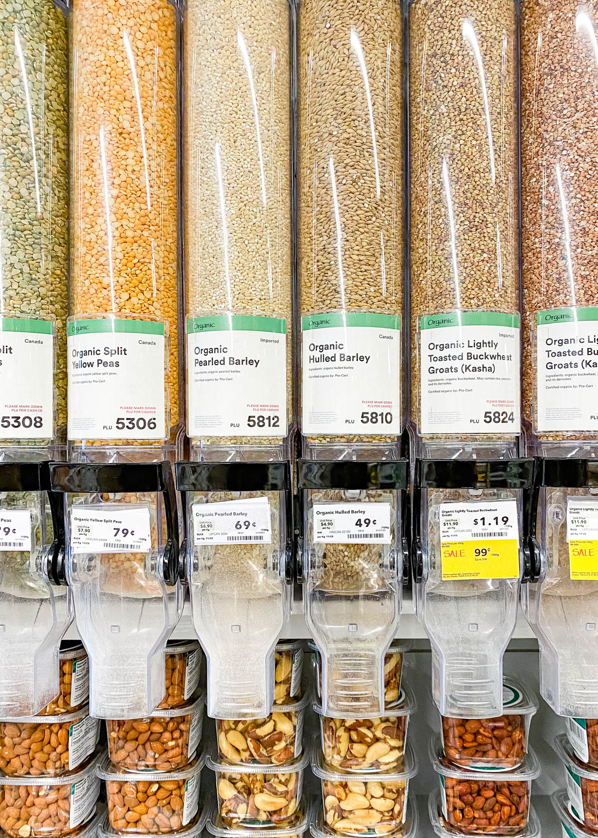 Bulk section of a grocery store showing barley in a hopper.