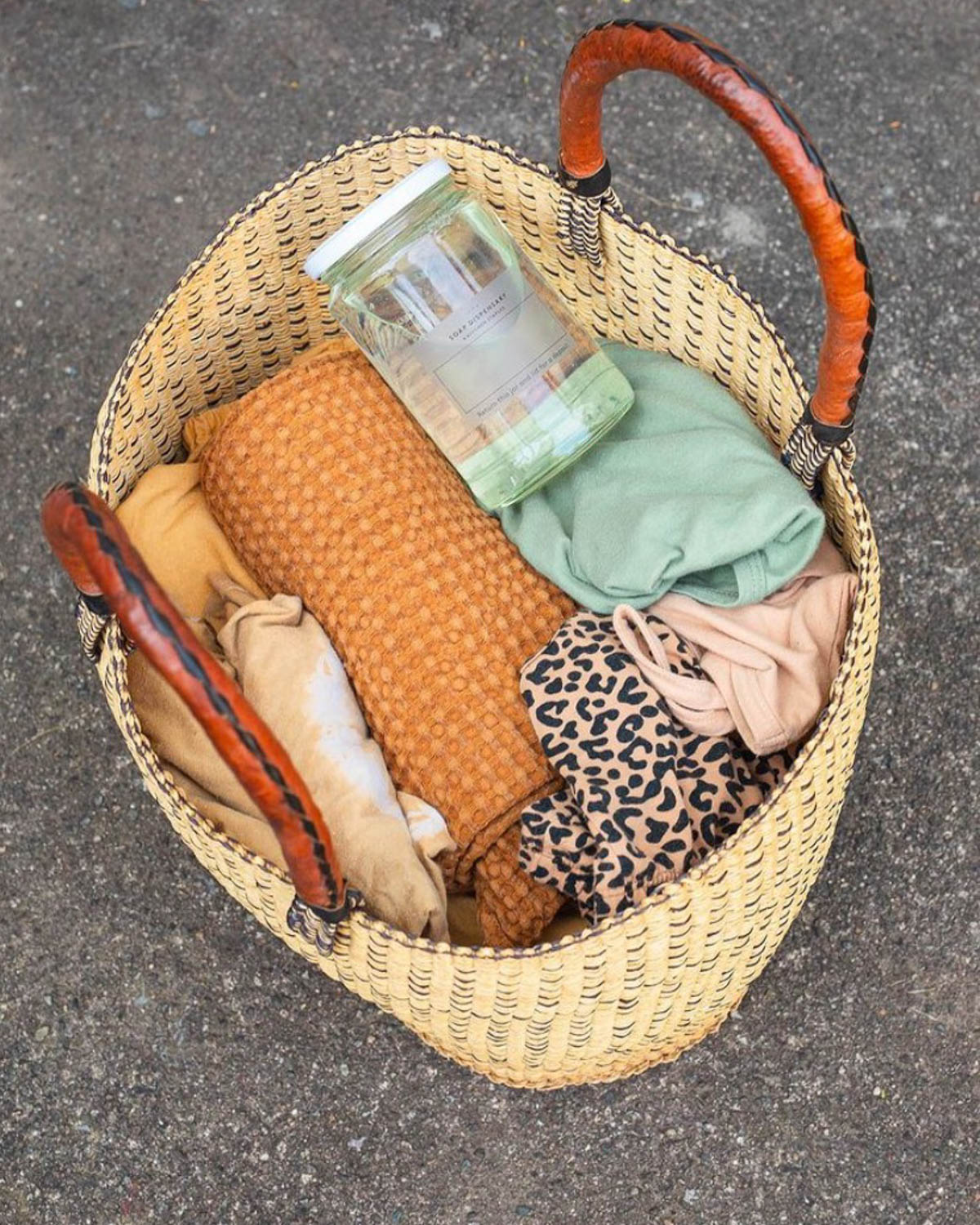 Basket filled with clothes and laundry soap