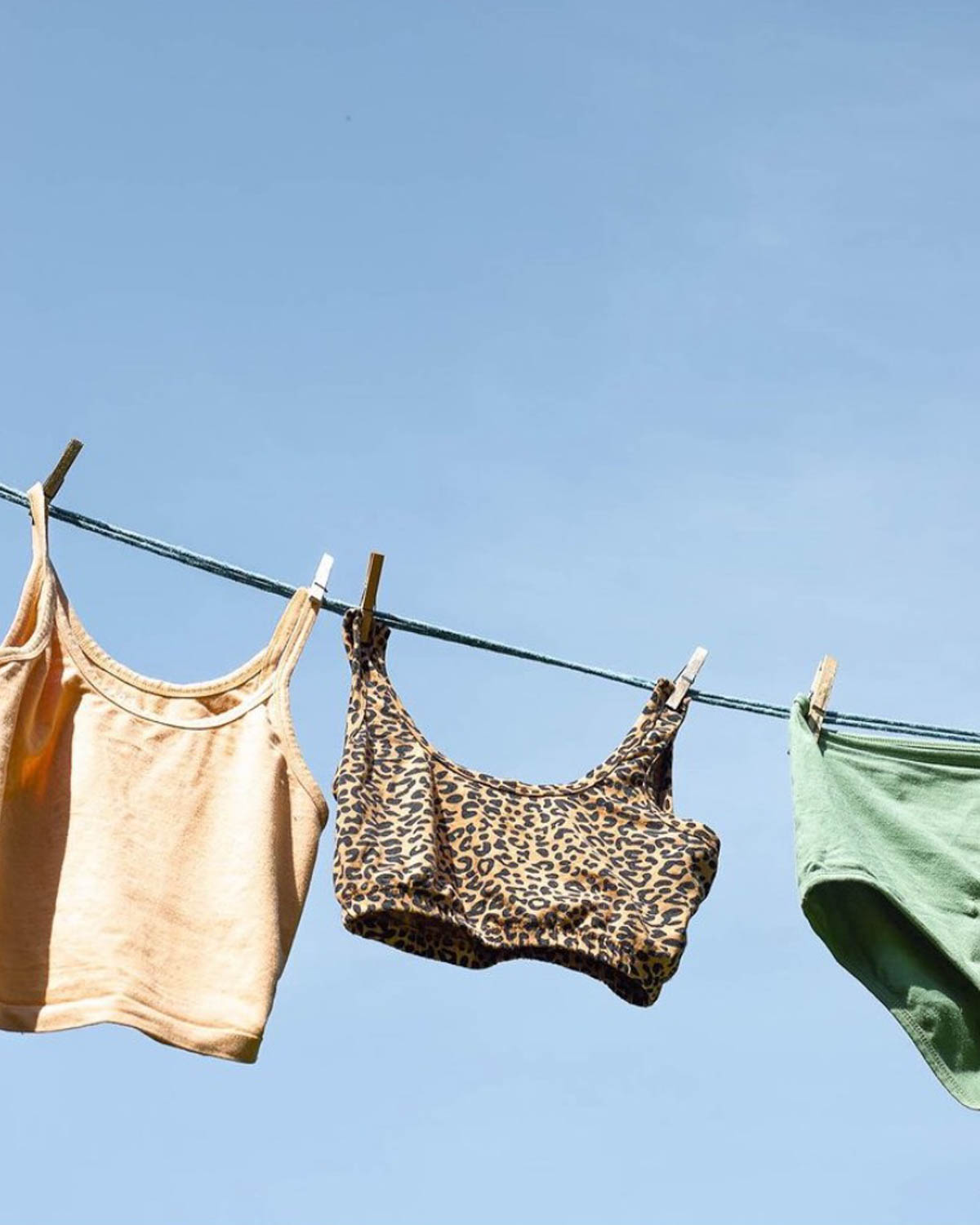 Clothing hanging up on a line against a blue sky