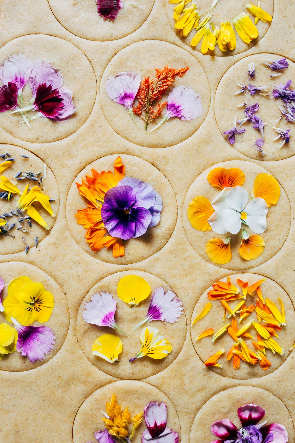 Pansies and other edible flowers on cookies