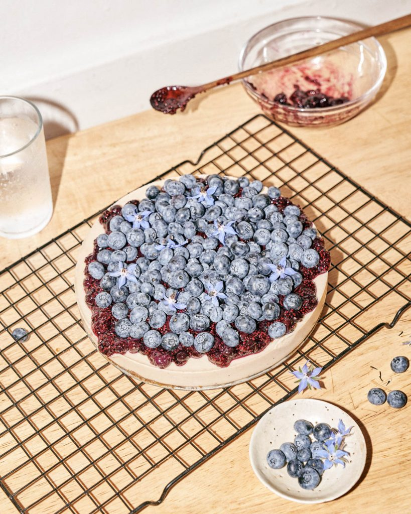 Finished blueberry cheesecake on a kitchen counter